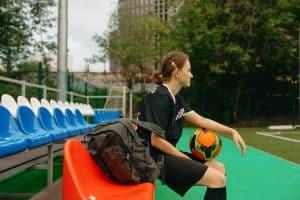 Female Soccer Player On Bench