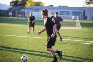 Player dribbling soccer ball
