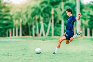 Kid Participating In Soccer Lessons For Beginners